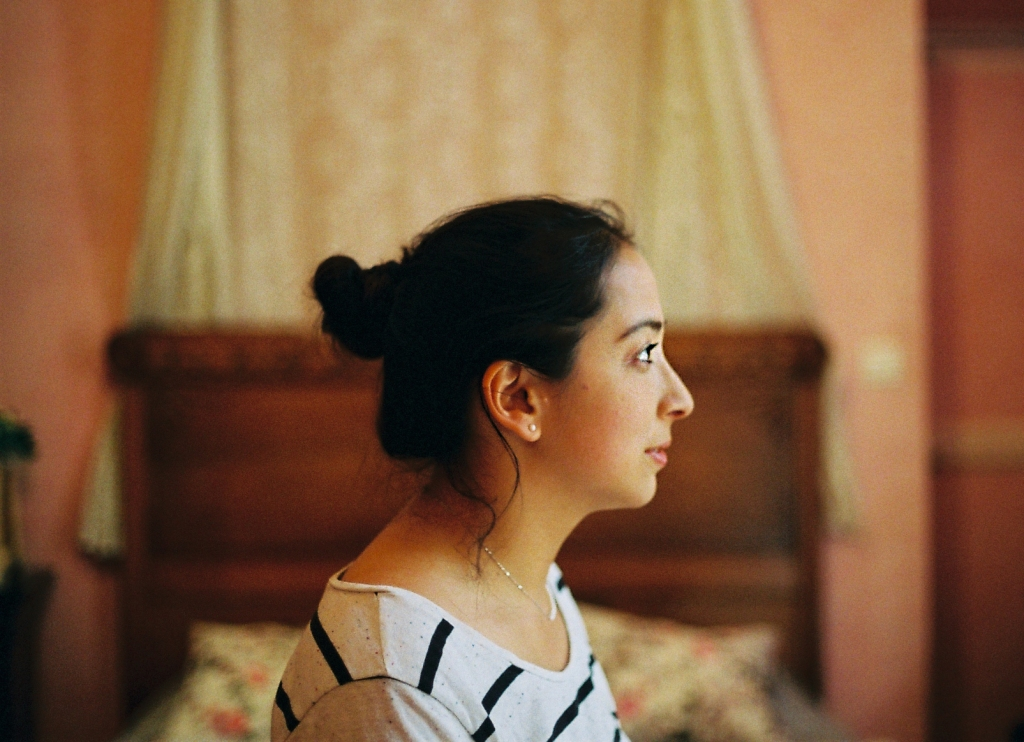 profile portrait of girl in a pink room